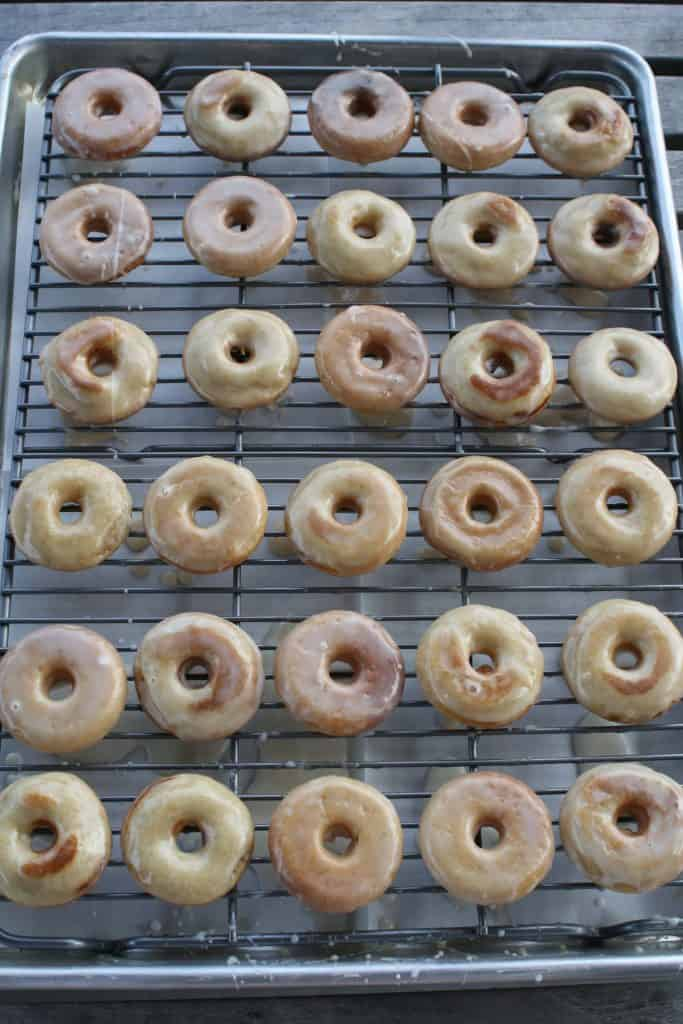 gluten free vanilla cake donuts on a cooling rack