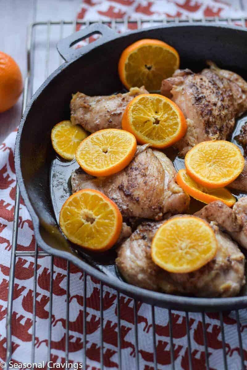 orange chicken in a cast iron skillet