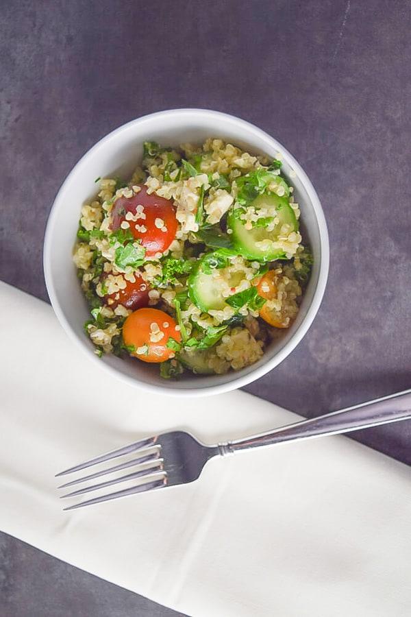 quinoa salad in a white bowl