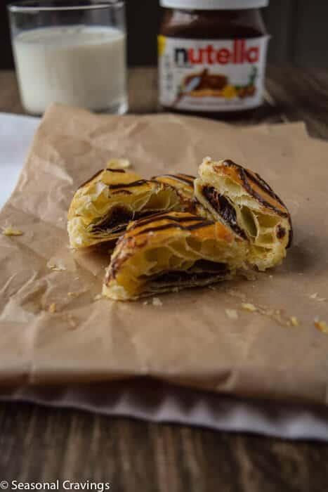 Nutella Puffs with puff pastry cut in half with chocolate in center