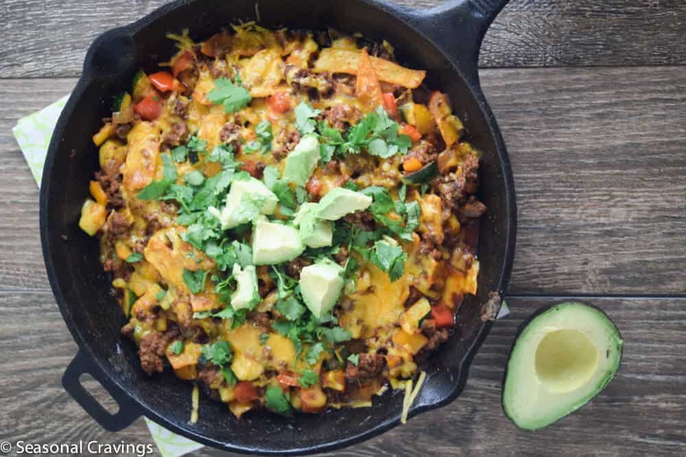 Beef Enchilada Skillet topped with cilantro and avocado