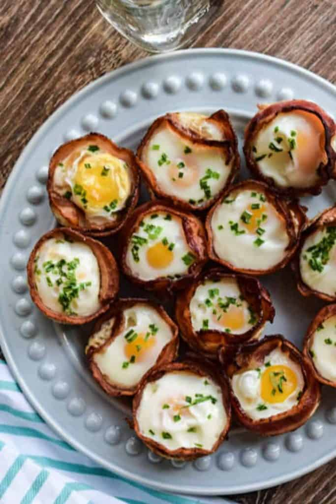 Bacon and Egg Cups on a blue plate