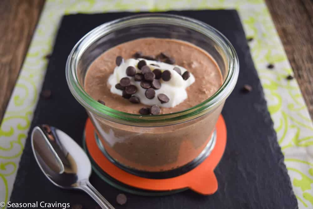 Overnight Chocolate Oatmeal Protein Bowl with chocolate chips and a spoon