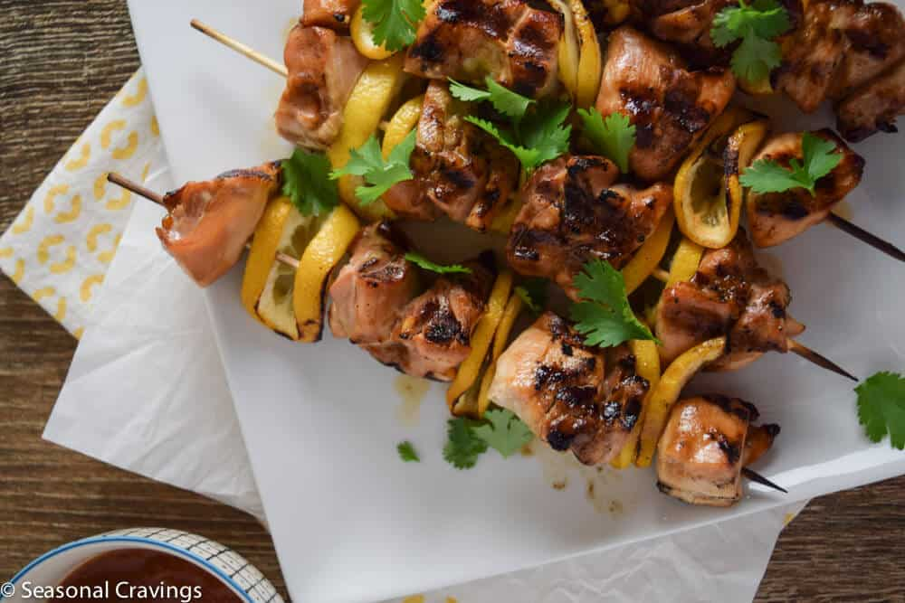 Pineapple Chicken on skewers with lemon slices