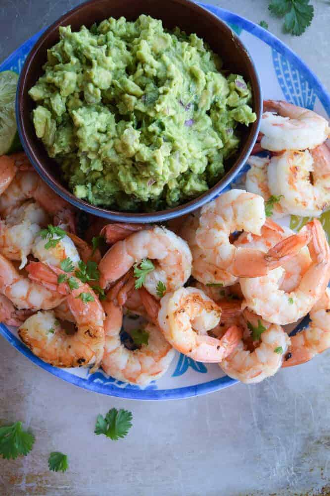 Smoky Shrimp With Guacamole on a blue plate