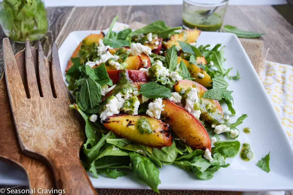 Grilled Peach Salad with serving utensils