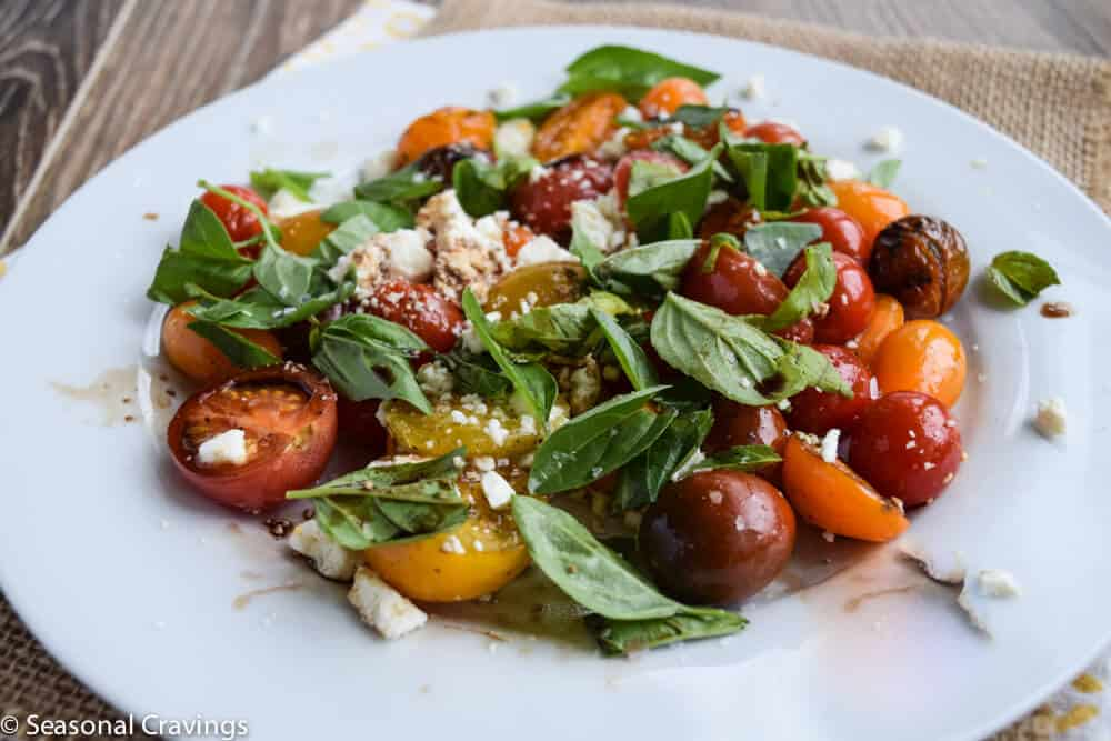 Tomato Salad With Basil on top