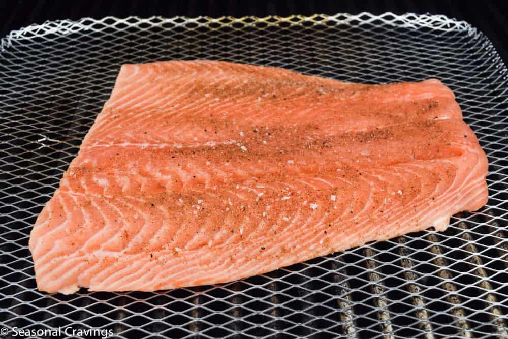Salmon on a grill sheet