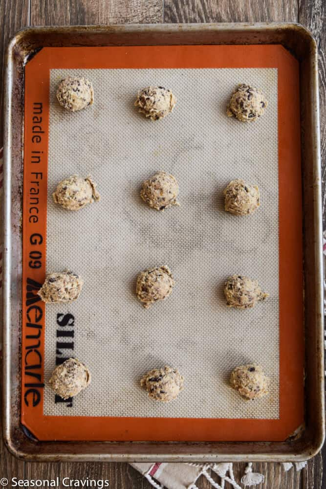 raw chocolate chip cookies on baking sheet