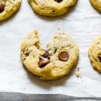 Close up of chocolate chip cookie on parchment paper