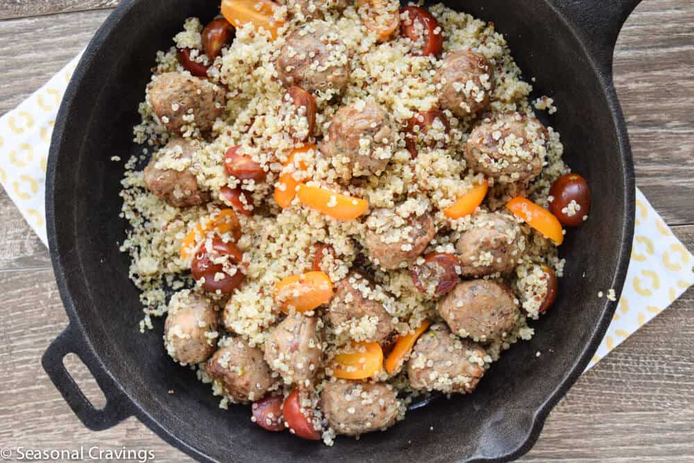 meatballs and quinoa in a skillet overhead shot