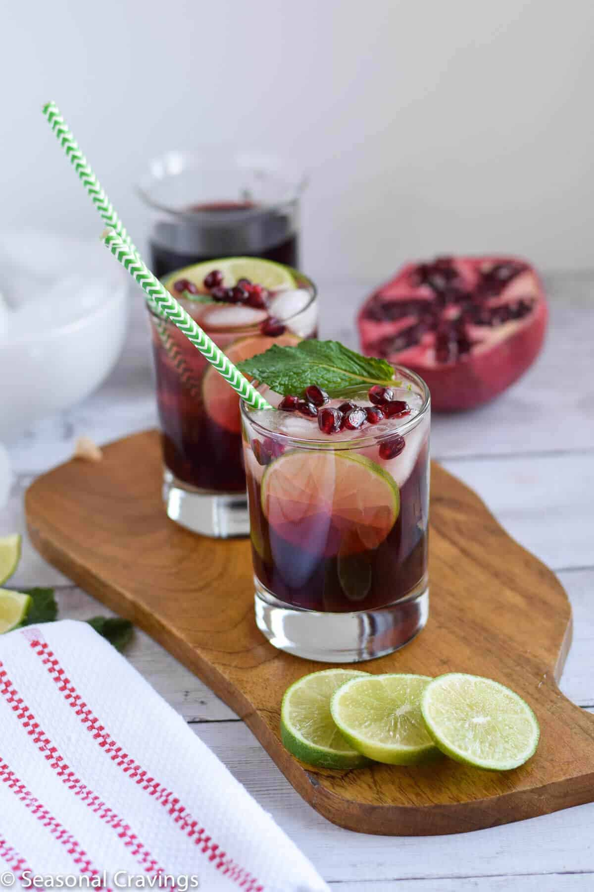Easy Pomegranate Mojito in two glasses with pomegranate on the side