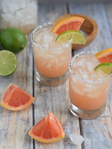 Two Sweet Grapefruit Margaritas in glasses with lime garnish