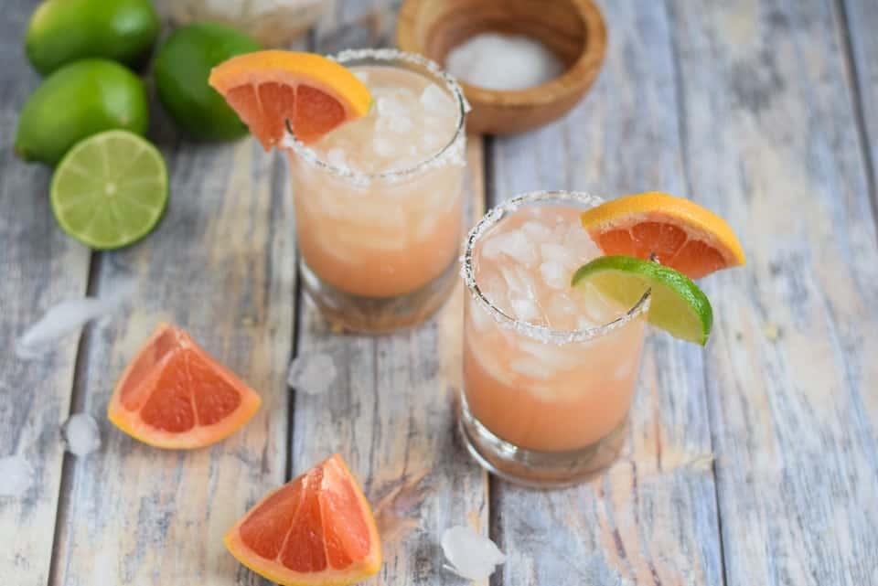 two sweet grapefruit margaritas in two glasses with salt