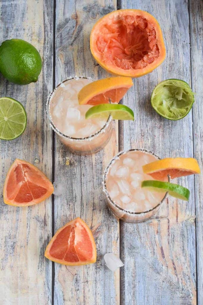 Two Sweet Grapefruit Margaritas with sliced fruit