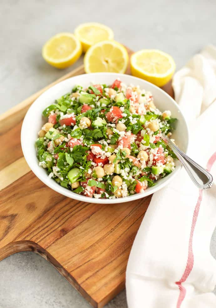 Cauliflower Tabbouleh on a white plate on a cutting board