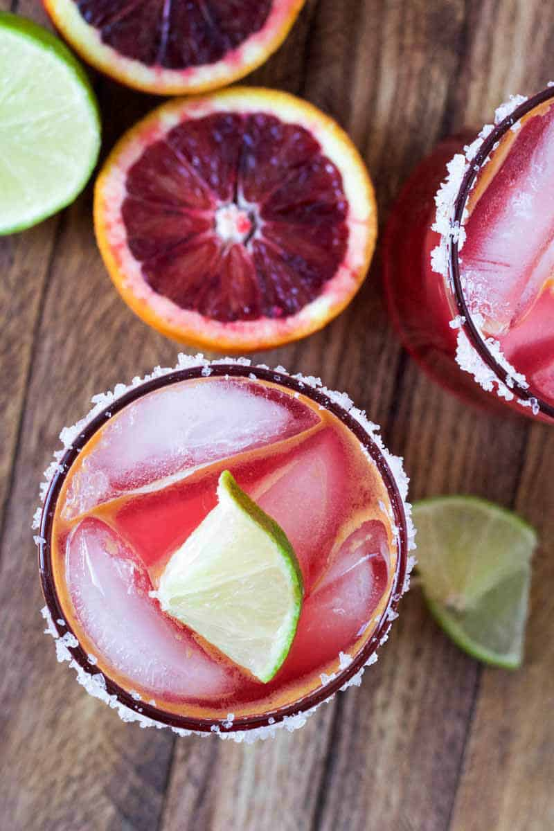 blood-orange-margarita with oranges and limes on the side