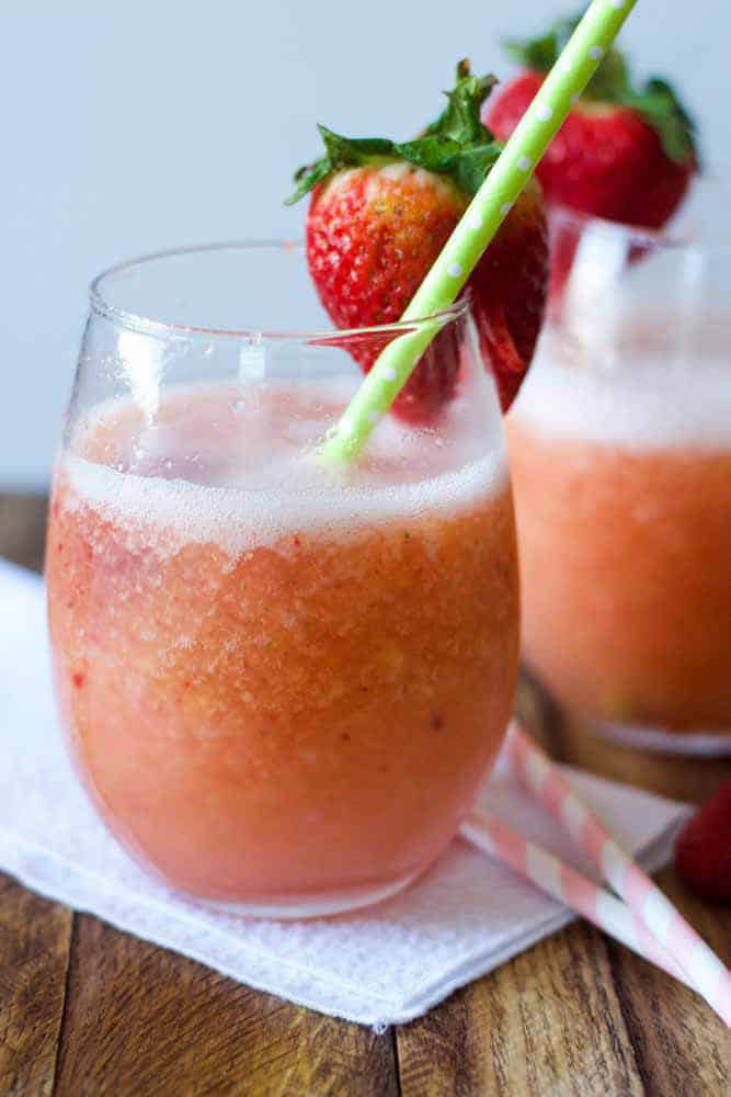 Frozen Sangria with strawberries and a straw