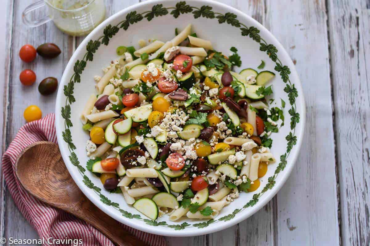 Greek Pasta Salad with tomatoes, zucchini and feta cheese