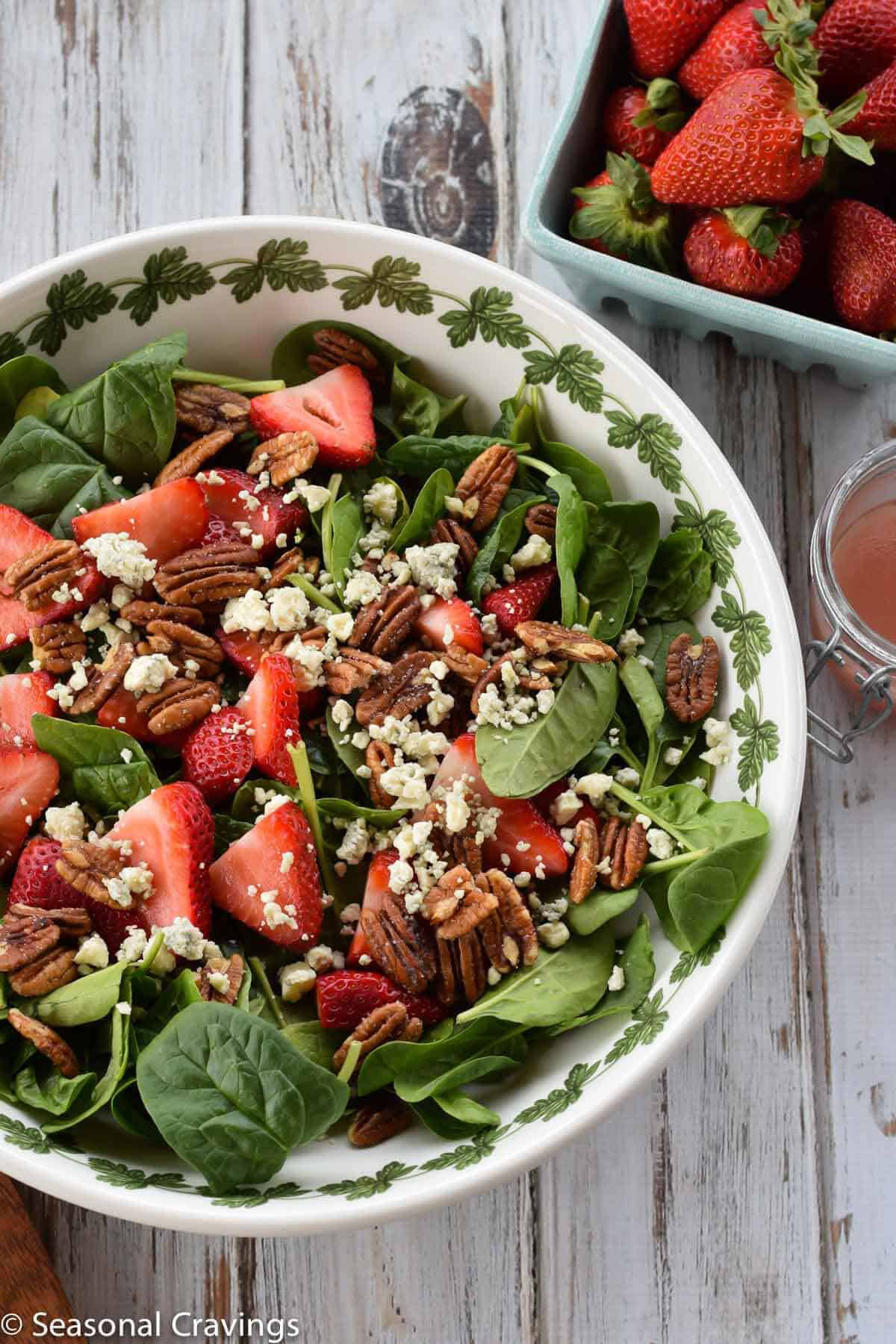 Strawberry and Pecan Spinach Salad in a white bowl