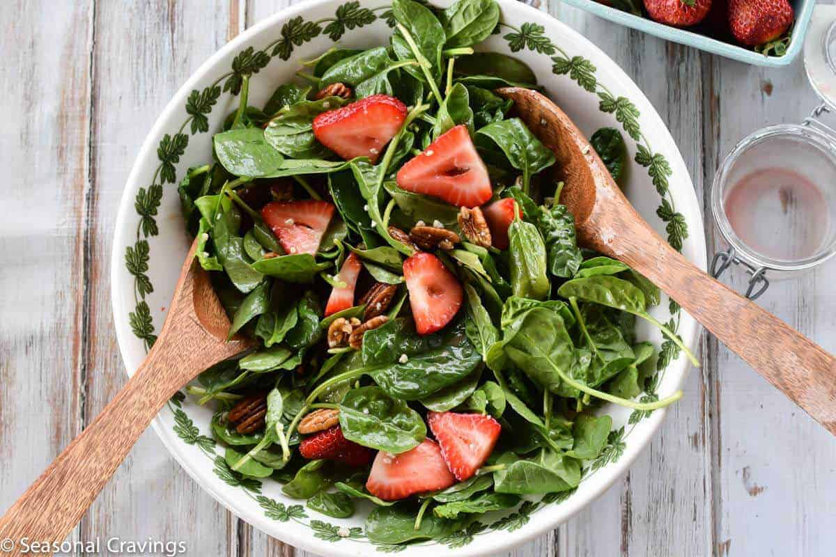Strawberry and Pecan Spinach Salad tossed with dressing