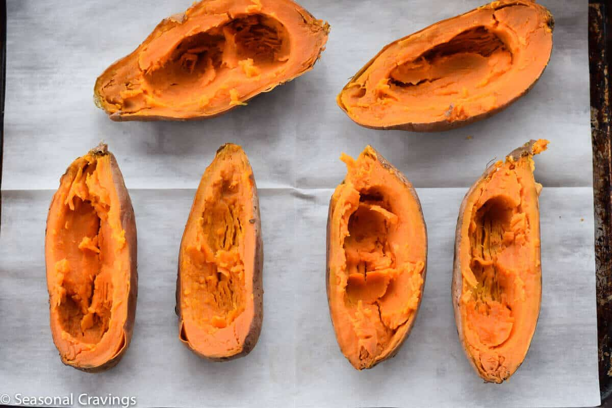 Baked Sweet Potatoes with Egg on white parchment paper