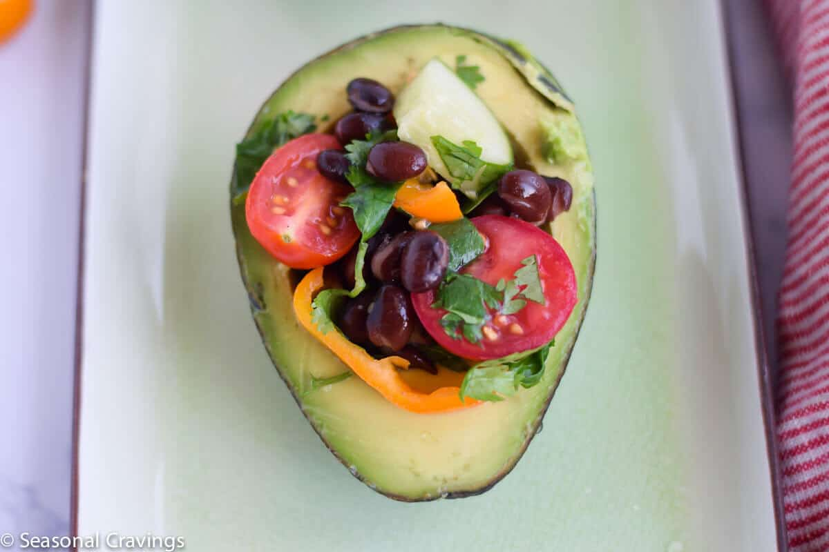 Skinny Cucumber and Tomato Salad in an avocado