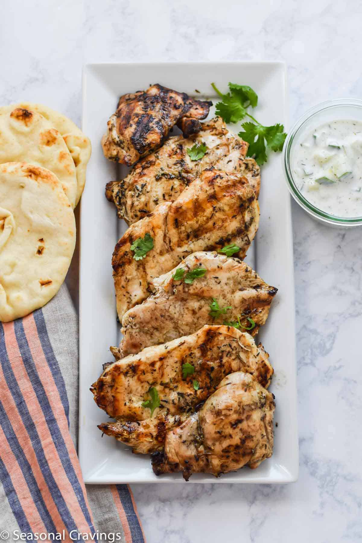 Grilled Chicken Souvlaki on a white plate with bread
