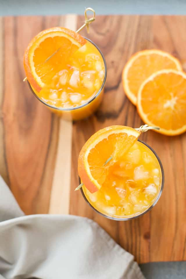 Turmeric Tea Recipe with orange garnish
