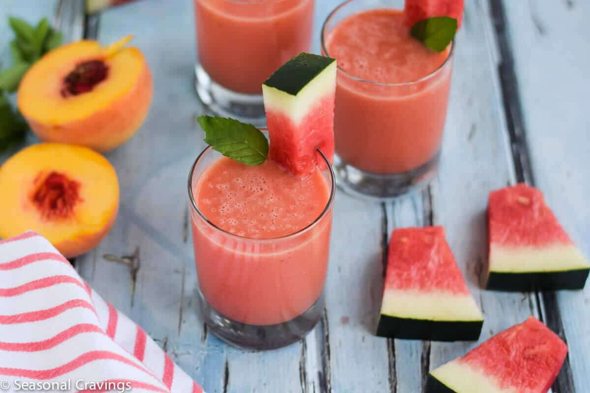 Watermelon Peach Smoothie in glass with peaches on side