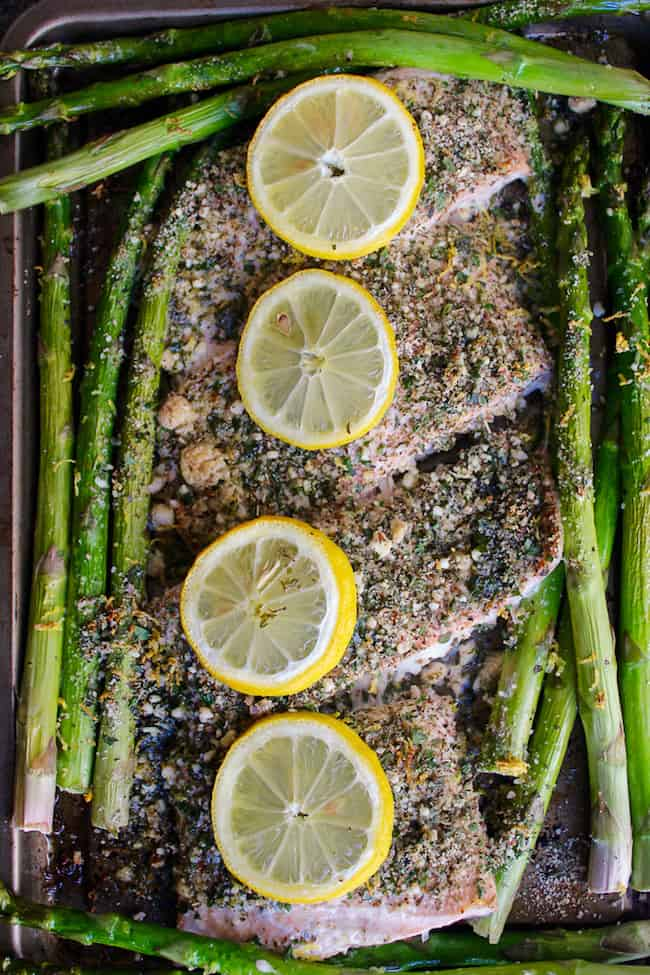 Almond and Herb Crusted Salmon with lemon and asparagus on a sheet pan