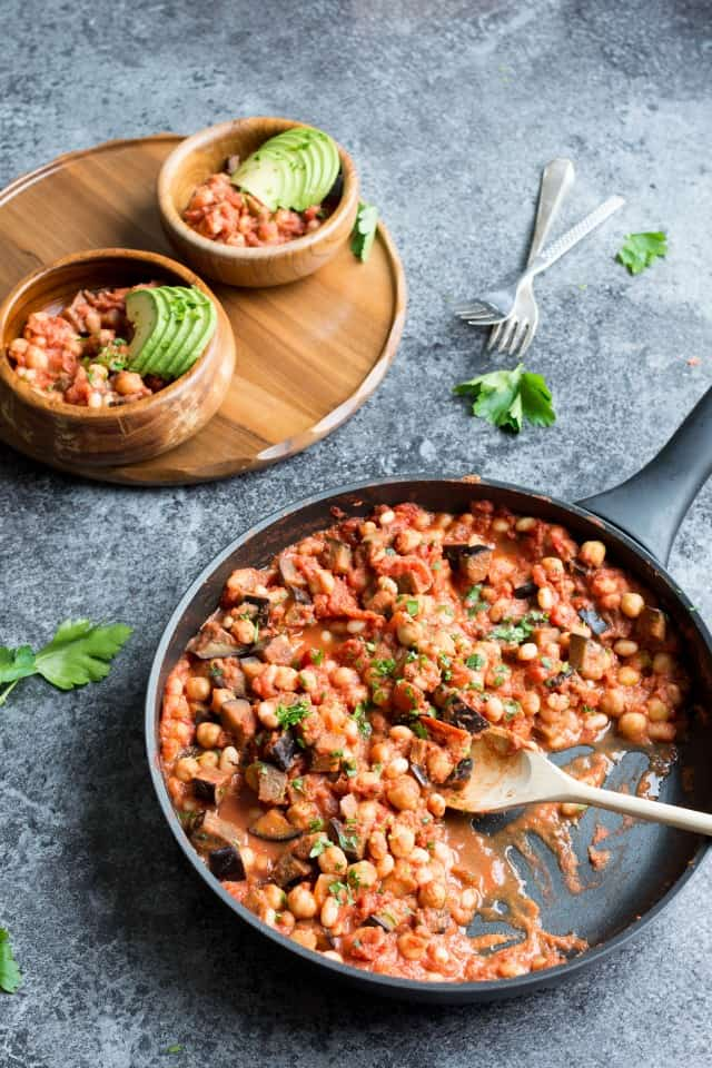 Bean Casserole with avocado and parsley with a wooden spoon