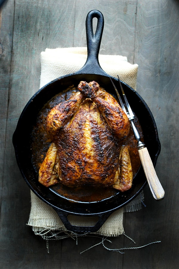 Rotisserie Inspired Roasted Chicken in a cast iron skillet