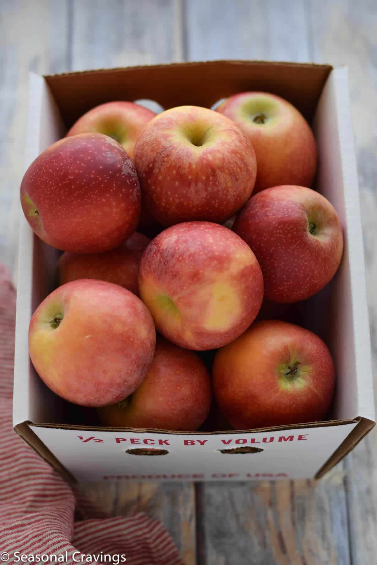 box of fresh red apples