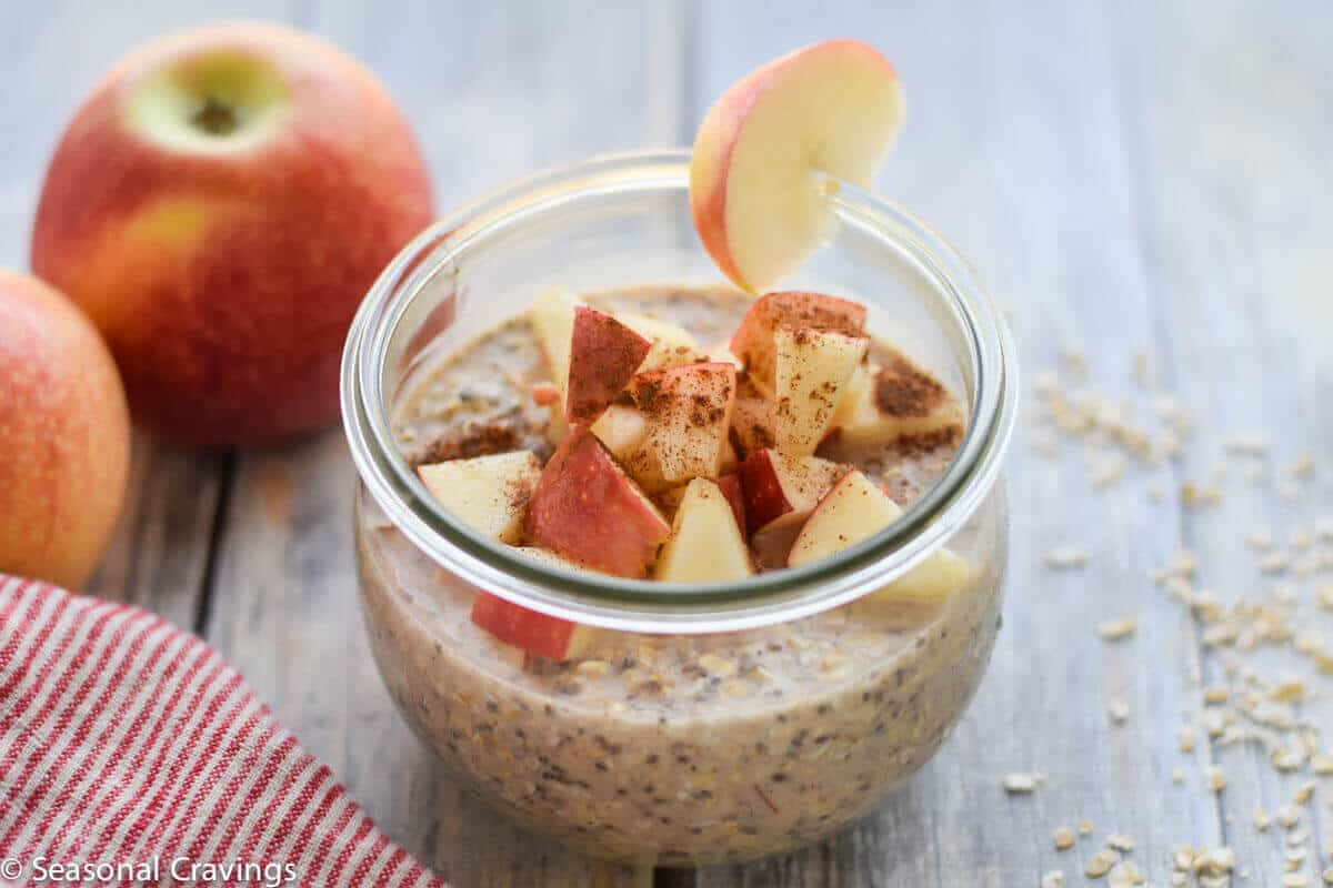 Apple Pie Overnight Oats in a jar with apples on the side
