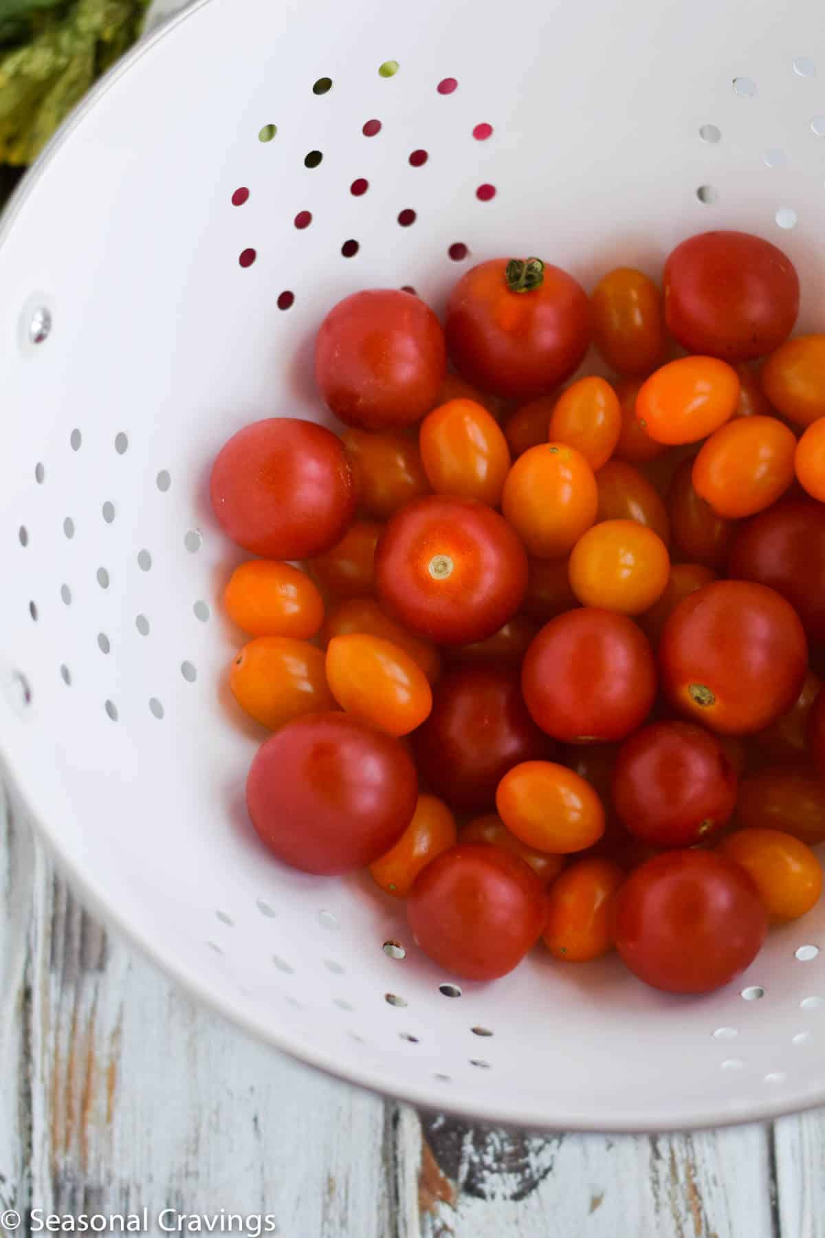 Late Summer Quinoa Grain Bowl tomatoes in a colander