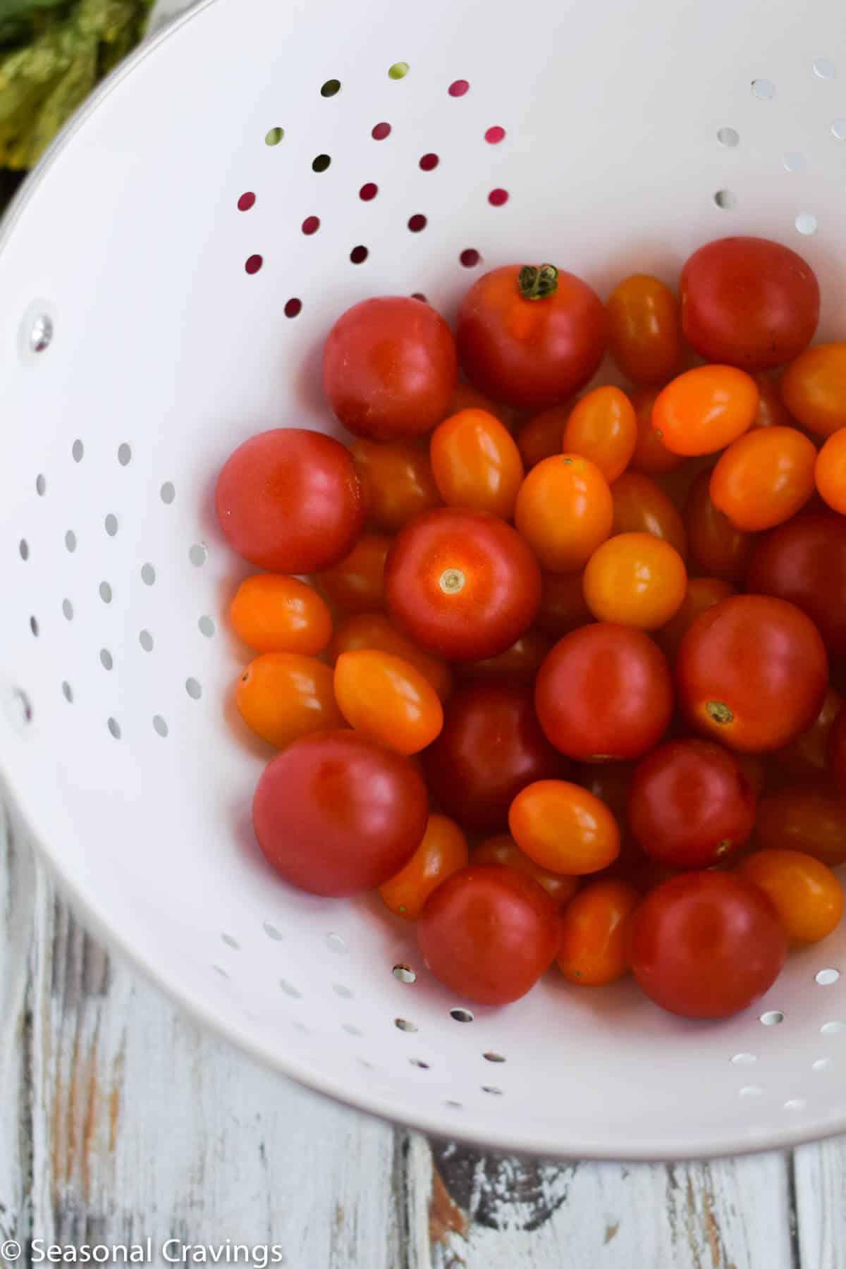 Late Summer Quinoa Grain Bowl tomatoes in a colander