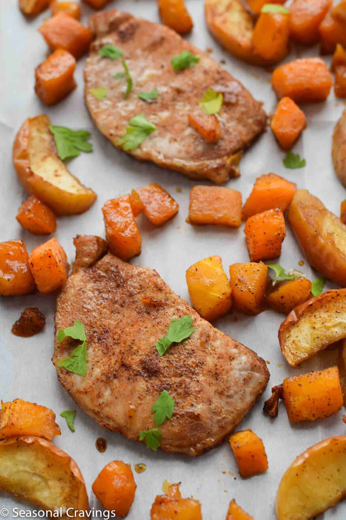 Sheet Pan Brown Sugar Pork Chops on parchment paper