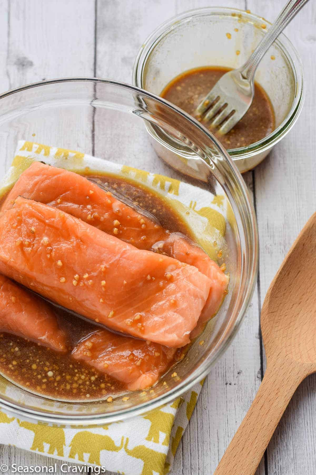 Easy Teriyaki Salmon with raw salmon and marinade in bowl on the side