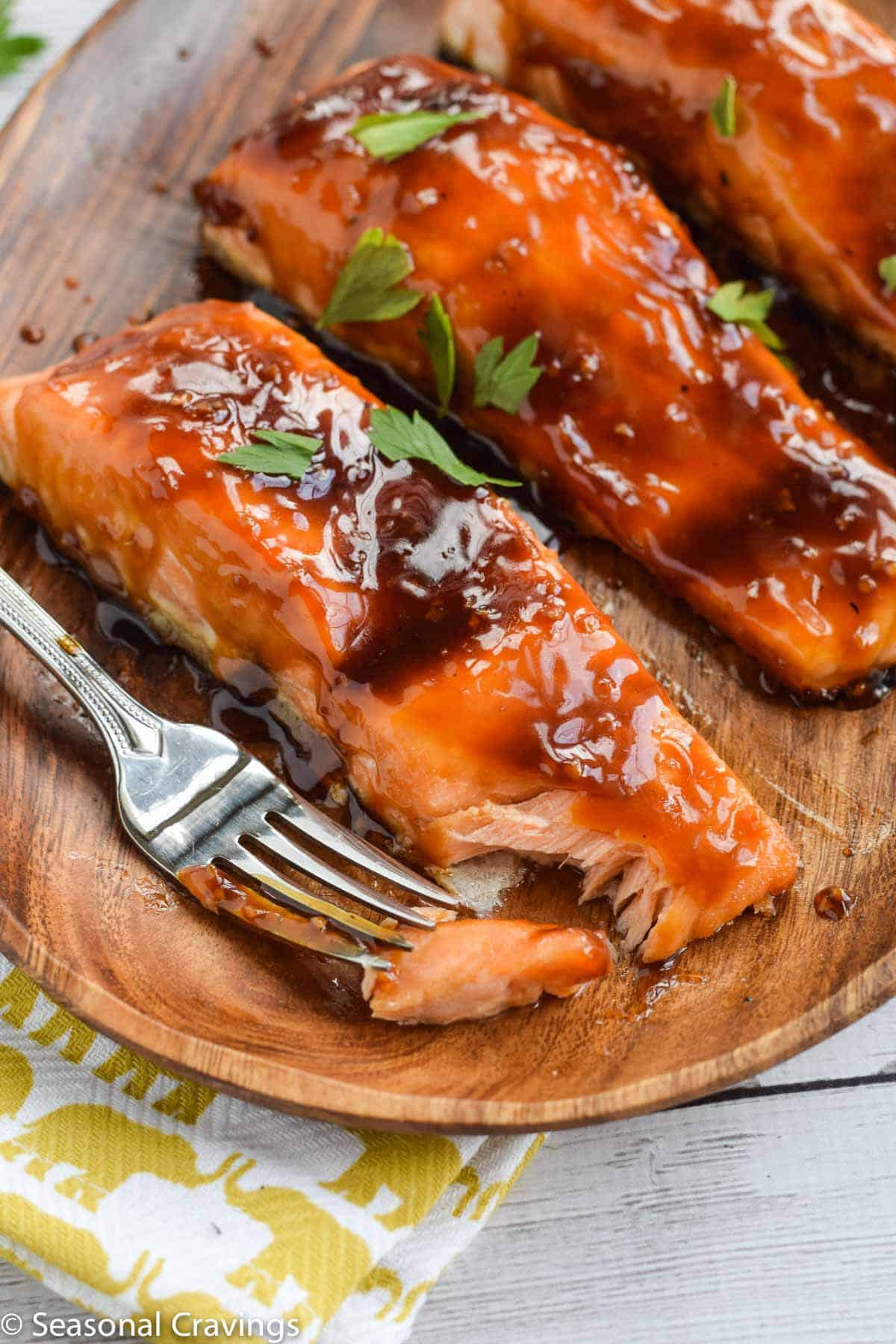 Close up of Easy Teriyaki Salmon with sticky sweet glaze and fork