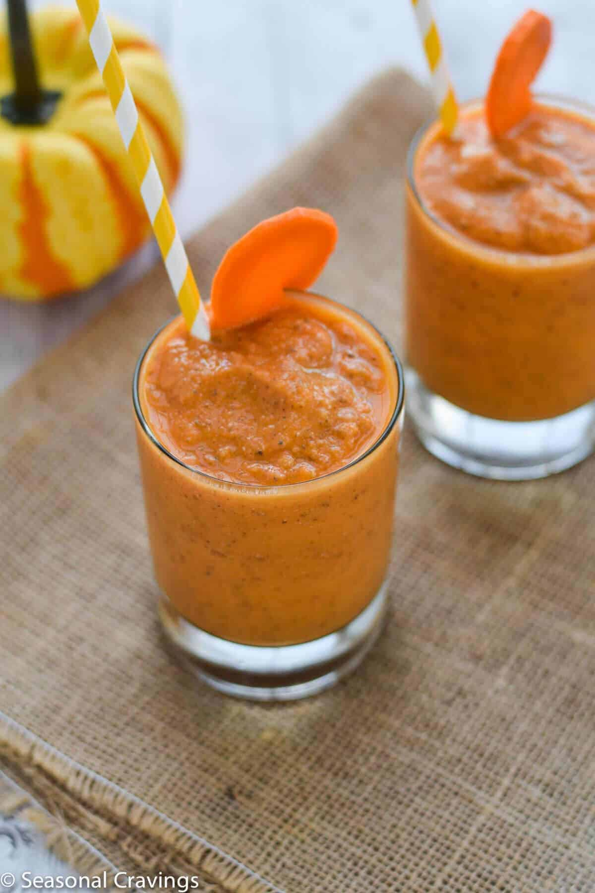 Mango Carrot Chia Smoothie fresh, healthy and delicious breakfast with straw and carrot garnish