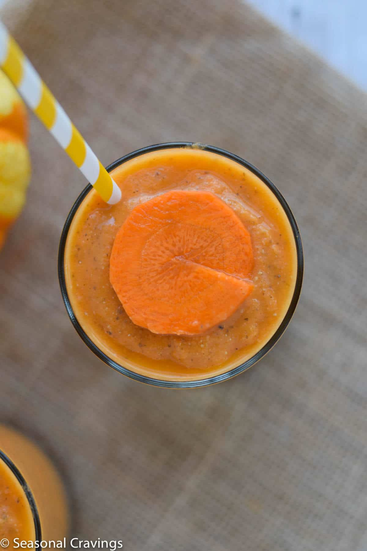 Close up of Mango Carrot Chia Smoothie with round carrot slice on top