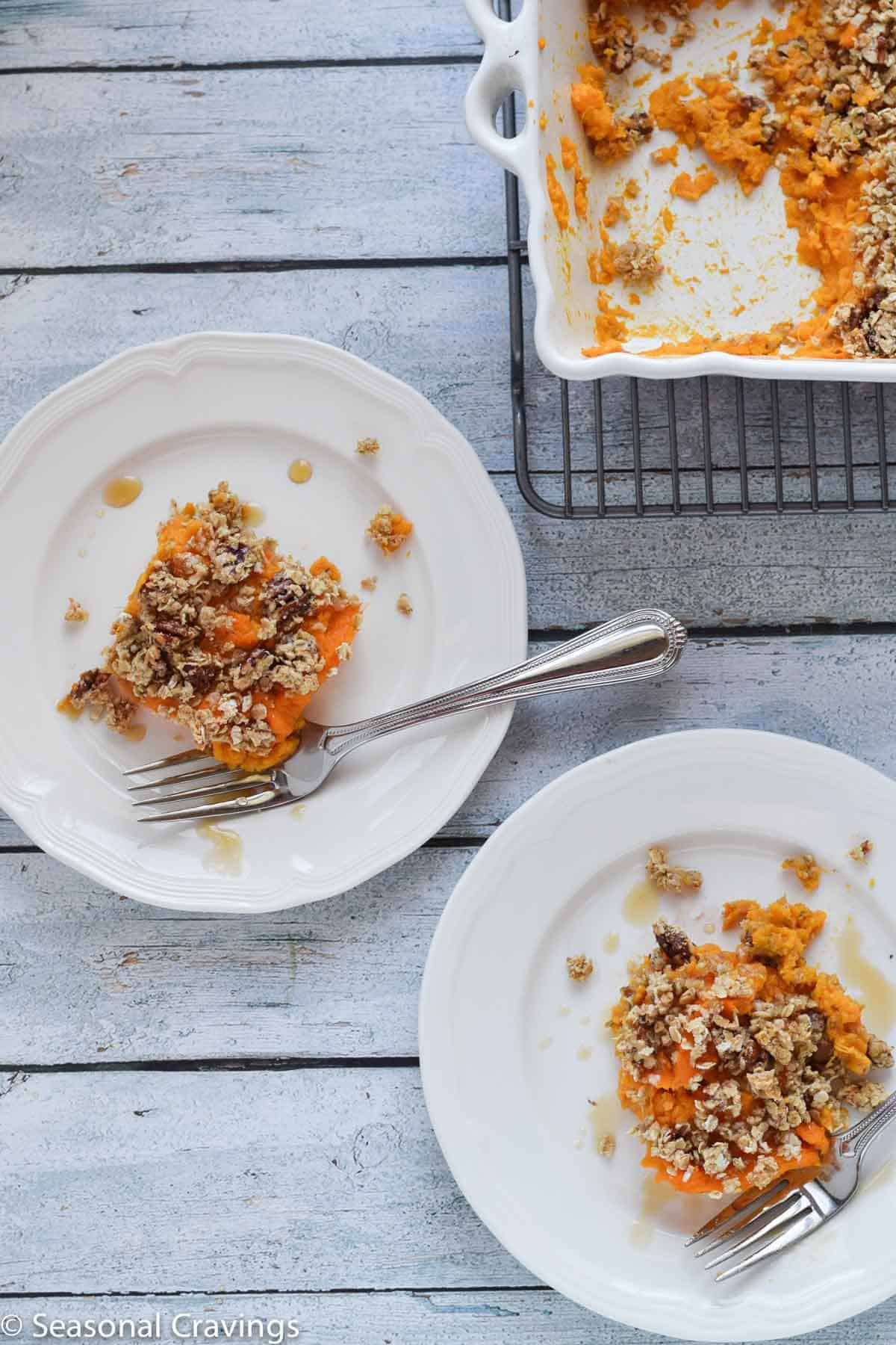 Gluten Free Sweet Potato Casserole topped with oatmeal crumb topping on white serving plates