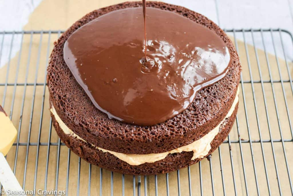 Chocolate Cake with Pumpkin Filling - moist chocolate cake, filled with creamy sweet pumpkin filling topped with a not too sweet chocolate ganache