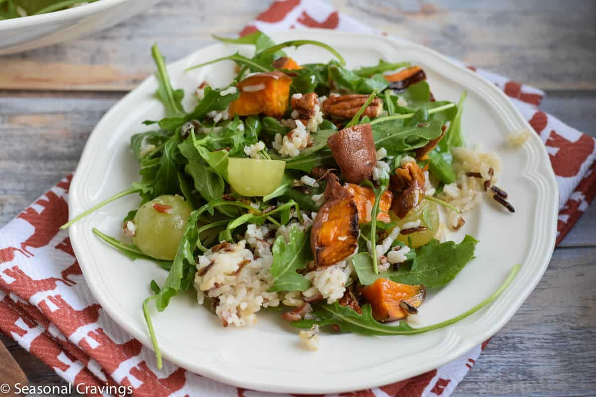 Fall Wild Rice Salad- full of roasted sweet potatoes, arugula, and sweet grapes. {gluten free, vegan, dairy free}