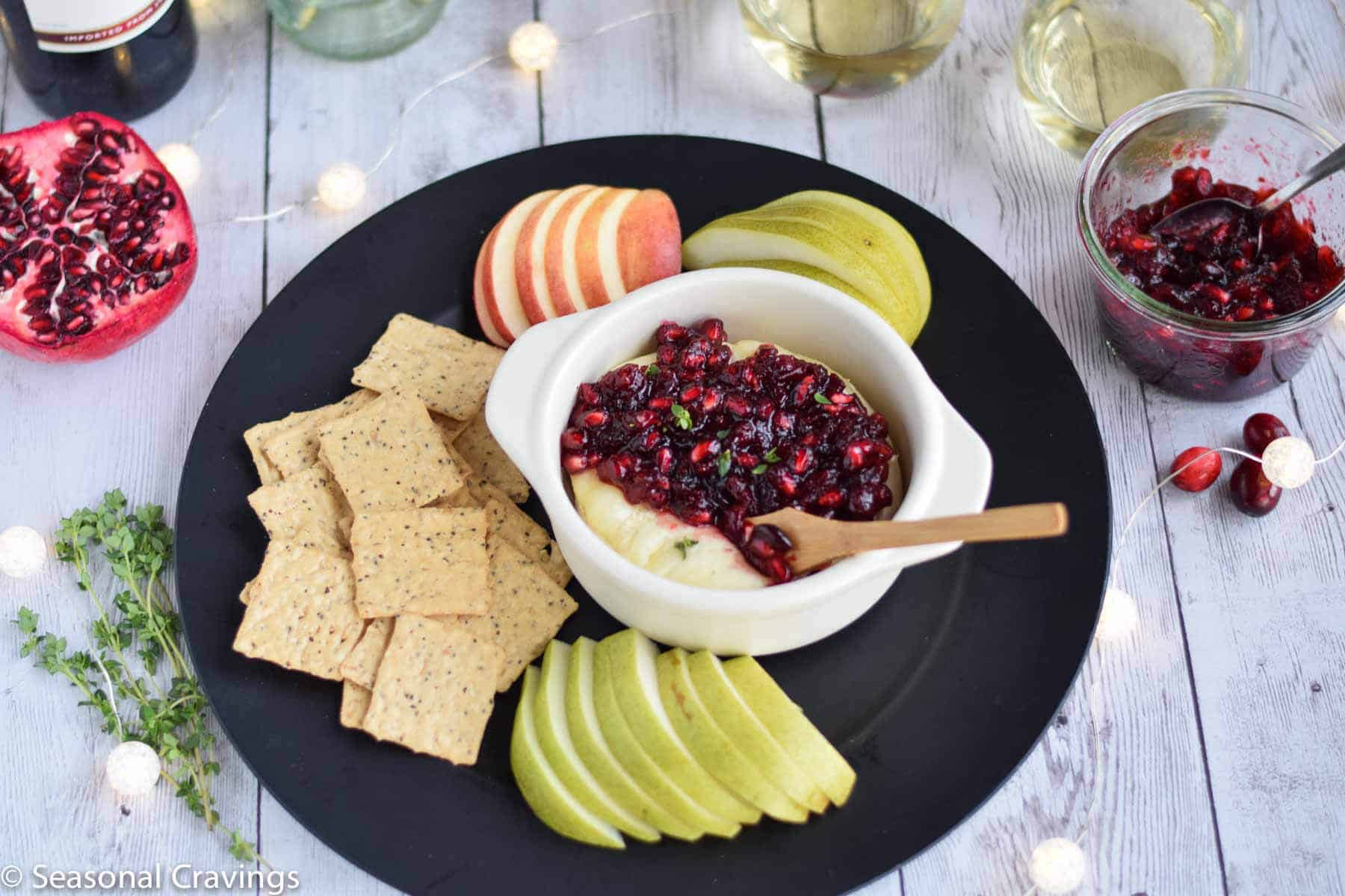 Pomegranate Cranberry Baked Brie is the perfect sweet and salty appetizer for any party.