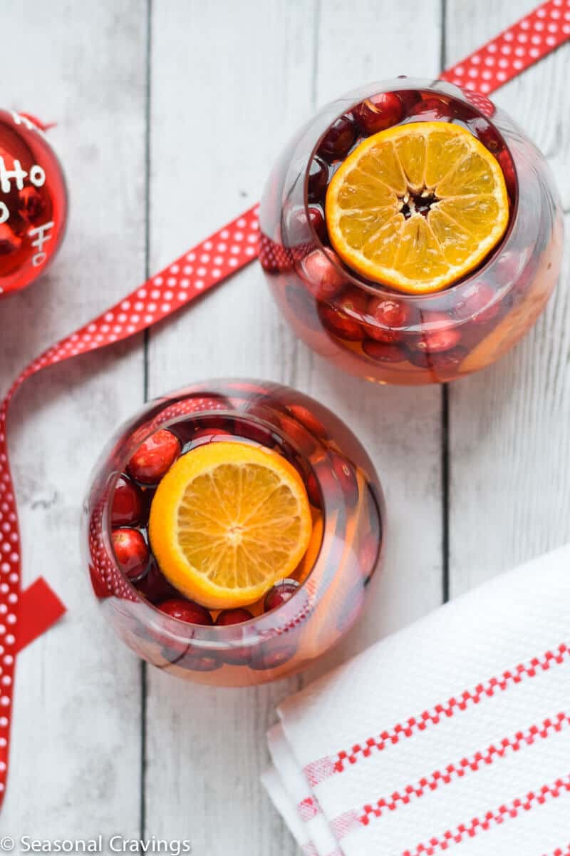 Five Ingredient White Sangria in two glasses with a red ribbon