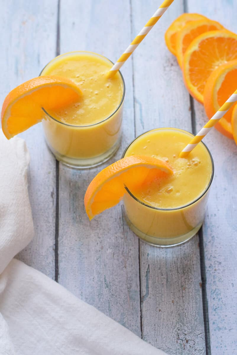 Cold Buster Citrus Smoothie two glasses with orange garnish