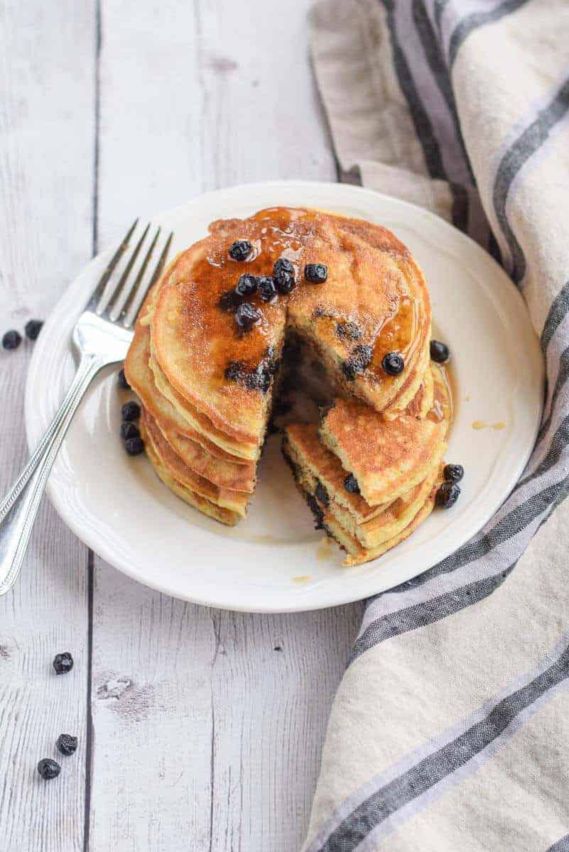 Paleo Blueberry Pancakes made with coconut flour - They are full of protein with four eggs and will keep you full until lunch. {paleo, whole30, gluten free}