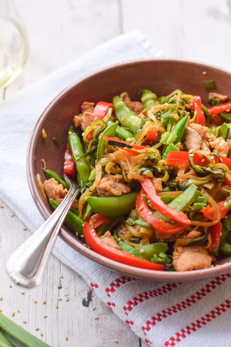 Zucchini Noodle Stir Fry with Chicken close up with a fork